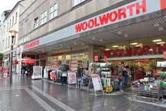 Woolworth GmbH store. HATTINGEN, GERMANY - JULY 16, 2012: People visit Woolworth discount store in Hattingen, Germany. Woolworth GmbH plans to have 500 stores in Stock Image