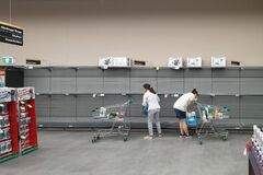 Woolworths supermarket empty toilet paper shelves amid coronavirus fears and panic buying
