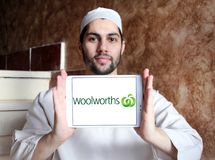 Woolworths Supermarkets logo. Logo of Woolworths Supermarkets on samsung tablet holded by arab muslim man. Woolworths is an Australian supermarket grocery store Royalty Free Stock Photography