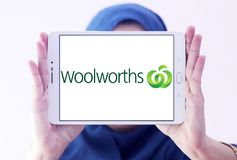 Woolworths Supermarkets logo. Logo of Woolworths Supermarkets on samsung tablet holded by arab muslim woman. Woolworths is an Australian supermarket grocery Royalty Free Stock Photography