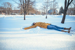 Wooman making Snow angel Stock Photo