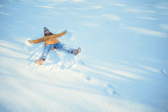 Wooman making Snow angel Royalty Free Stock Photo