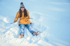 Wooman making Snow angel Stock Image