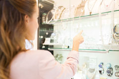 Free Wooman Pointing Finger To Window At Jewelry Store Stock Image - 63507451