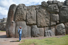 Woman and Sacsayhuaman Ruins, Cuzco, Peru. Royalty Free Stock Images
