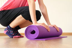 Wooman with yoga mat Stock Image