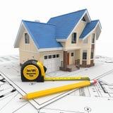 Woon huis met hulpmiddelen op architectenblauwdrukken. Stock Foto