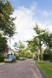 Woonwijk, Residential area. Straat in woonwijk met geparkeerde auto's; Street in residential area with parked cars royalty free stock image