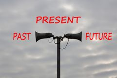 Past present and future time progress concept. Woord Past, Present, Future and vintage loudspeakers against sky with clouds. Business Concept stock photography