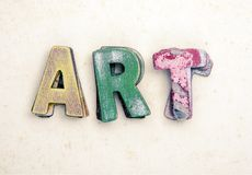 The wor ART wit old wooden letters. On old paper royalty free stock photography