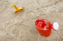 Wor holidays in sand with beach toys Stock Photo