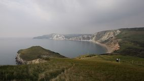 Worbarrow Bay east of Lulworth Cove Dorset coast England uk pan view. Worbarrow Bay east of Lulworth Cove and near Tyneham on the Dorset coast England uk pan stock video
