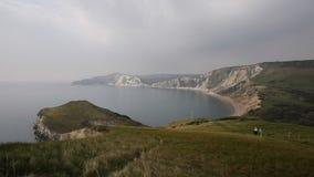 Worbarrow Bay east of Lulworth Cove Dorset coast England uk pan view stock video
