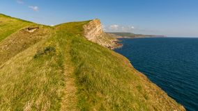 Worbarrow Bay, Jurassic Coast, Dorset, UK. Cliffs at the Jurassic Coast, seen on South West Coast Path between Worbarrow Bay and Brandy Bay, Dorset, UK Stock Photos