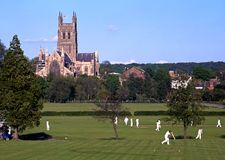 Worcester Cathedral and cricketers. View of the Cathedral with a cricket match in progress in the foreground, Worcester, England, UK, Western Europe stock photos