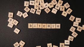 Word «Bitcoin` sets in letters on a black table Royalty Free Stock Images