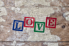 "Word ""LOVE"" on old wood background. Royalty Free Stock Photos"