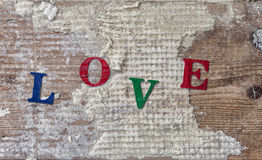 "Word ""LOVE"" on old wood background. Stock Photo"