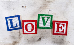 "Word ""LOVE"" on old wood background. Royalty Free Stock Images"