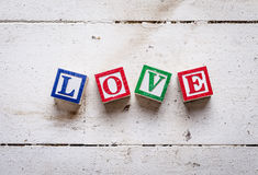 "Word ""LOVE"" on old wood background. Stock Images"