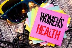 Word, écrivant à femmes la santé de s Concept d'affaires pour la célébration femelle écrite sur la note collante avec l'espace de Photos libres de droits