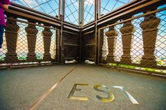Second floor of the Eiffel tower showing the word �est� in copper on the floor. stock images