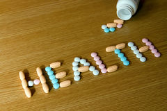 Word. A word health made of coloured vitamins and a bottle Royalty Free Stock Photo