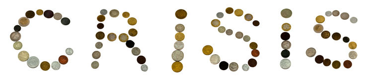 The word. Crisis written with coins on white background royalty free stock photography