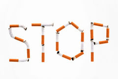 Word. Stop made of cigaret butts on a white background Stock Photography