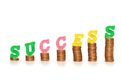 Word. Success  on top of coin stacks Stock Photos