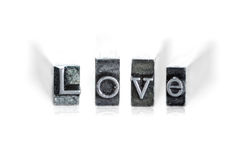 The word LOVE. In letterpress type on withe background - Macro Stock Image