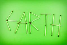 Word AARDE van matchsticks wordt gemaakt die Royalty-vrije Stock Fotografie