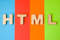 Word or abbreviation HTML, meaning HyperText Markup Language as internet programming language, is on background of four colors: bl. Ue, red, orange and green royalty free stock image