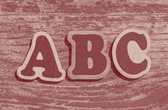 Word ABC made of wooden letters. On wood background stock photography