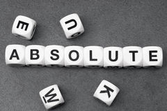Word absolute on toy cubes. Word absolute  on white toy cubes Royalty Free Stock Photography