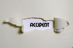 The word accident appearing behind torn paper Stock Images