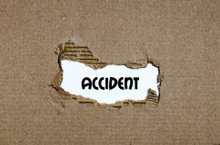 The word accident appearing behind torn paper Royalty Free Stock Photos