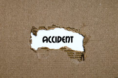 The word accident appearing behind torn paper. The word accident  behind torn paper Royalty Free Stock Photo