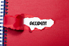 The word accident appearing behind torn paper. The word accident behind torn paper Stock Photos