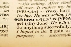 Word Achieve in a dictionary Royalty Free Stock Photos