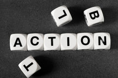 Word action on toy cubes Royalty Free Stock Image