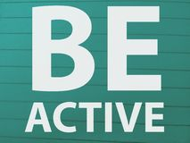 The word be active in large size word on a blue color. Word active larg large size blue color text font letter typography english motivate royalty free stock images