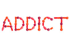 Word ADDICT made of red sugary candies Royalty Free Stock Images