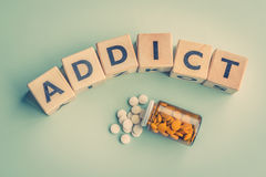 The word addict on a table. With pills Stock Image