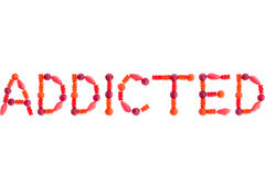 Word ADDICTED made of red sugary candies Stock Photo