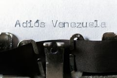 Word `Adios Venezuela` goodbye Venezuela typed on typewriter. Word `Adios Venezuela` goodbye Venezuela typed on white paper on vintage typewriter stock photography