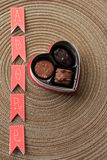 The word  'adore'  and a box of chocolates Royalty Free Stock Photo