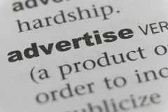 The Word Advertise Close Up.  Royalty Free Stock Photography