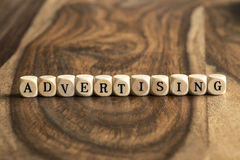 Word ADVERTISING on wooden cubes Royalty Free Stock Photos