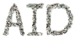 Aid - Crimped 100$ Bills. The word 'aid', made out of crimped 100$ bills Stock Images